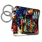 """Image Of Jamaican Hand Woven Clothing Key Chain is available in sets of 2, 4 and 6; making them perfect for sharing. Image is printed on both sides and has a high gloss finish. Measures 2 3/8"""" x 2 3/8"""" x 3/8"""" and are made of heavy duty durabl..."""
