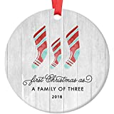 "First Christmas As A Family of Three Ornament 2018, Farmhouse Woodsy Newborn New Baby Parents Mom Dad Xmas Present Mommy Daddy Ceramic Porcelain Keepsake 3"" Flat Circle with Red Ribbon & Free Gift Box"