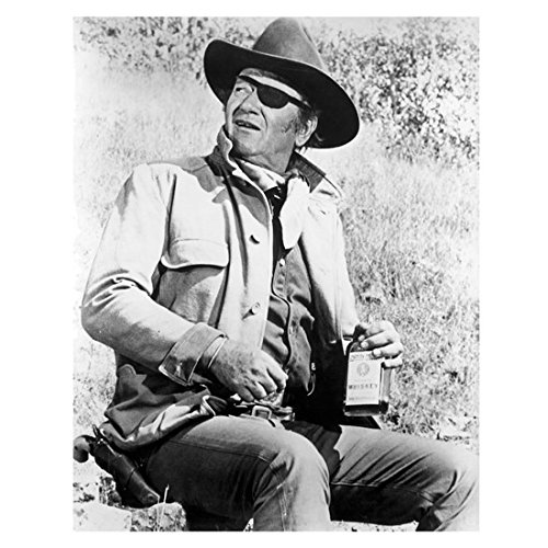 John Wayne The Duke 8 x 10 Photo Rooster Cogburn Sitting w/Bottle Black Eye Patch Looking Up and Talking kn