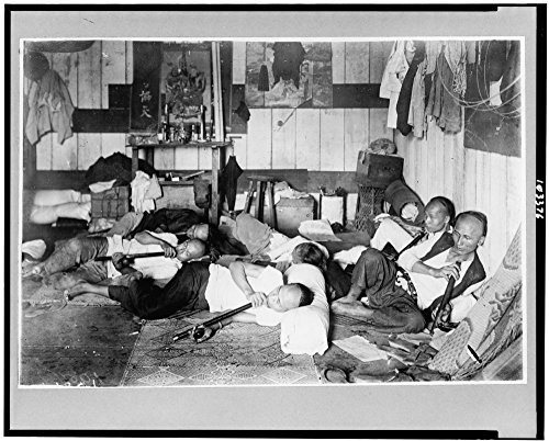 1924 Photo Opium den on Malinta Street, Manila, Philippine Islands an interior view of an opium den with several men reclining, smoking long opium pipes. Location: Manila, Philippines