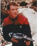 Robert Duncan McNeill as Tom Paris from Star Trek: Voyager in uniform standing holding weapon 8 x 10 photo