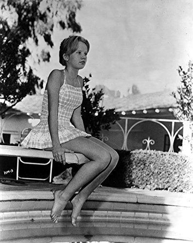 Hayley Mills sitting in Printed Dress Photo Print (24 x 30)