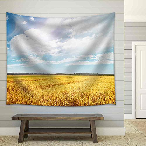 Beautiful View of The Field and The Blue Sky on a Sunny Day Fabric Wall