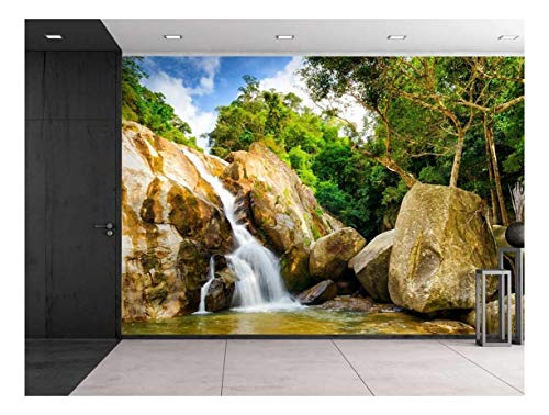Serene Rocky Waterfall Surrounded by Trees Wall Mural