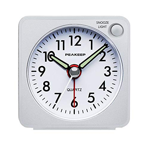 - Peakeep Ultra Small, Battery Travel Alarm Clock with Snooze and Light, Silent with No Ticking Analog Quartz (White)