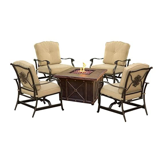 Hanover SUMMRNGHT5PCTAN Summer Night 5 Piece Fire Pit Conversation Set with Natural Oat Cushions Outdoor Furniture, Tan - Includes four spring-action rocking chairs and one 40 in. fire pit Each piece designed with premium all-weather materials for outdoor entertainment all year long Durastone LP gas fire pit (30,000 BTU) doubles as a coffee table - patio-furniture, patio, conversation-sets - 51EDyLHiQsL. SS570  -