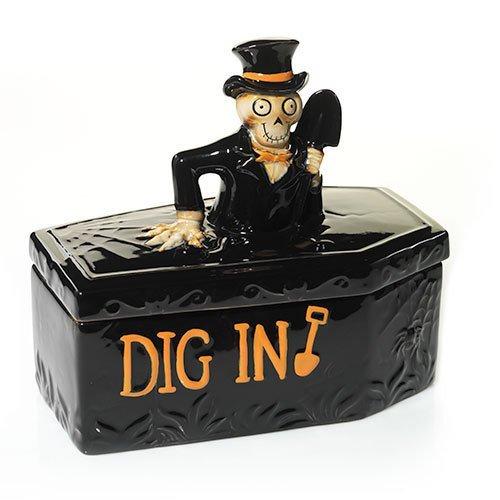 Black ceramic coffin casket with skeleton and shovel