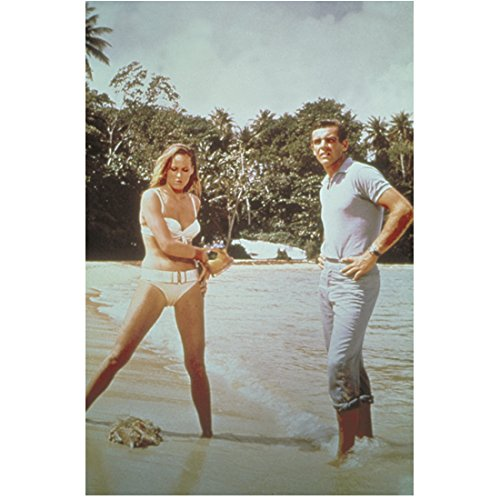 Sean Connery as James Bond Standing Near Ursula Andress as Honey Ryder Bare Skin Showing in Dr. No 8 x 10 Inch Photo