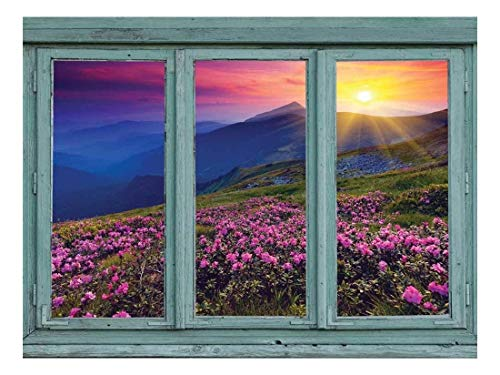 A Colorful Sunset Over Blue Mountains and Rocky Soil with Pink Flowers in Bloom Wall Mural