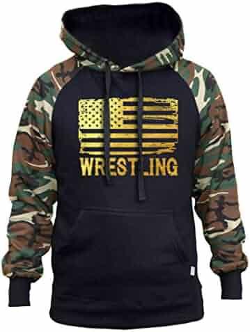 d25ed74413930 Interstate Apparel Men s Gold Foil Wrestling American Flag Black Camo  Raglan Baseball Hoodie Black