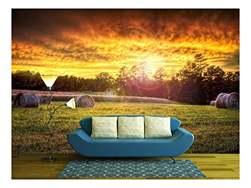 wall26 - Beautiful Sunset Lighting a Field with Hay Rounds Producing Brilliant and Amazing Colors. - Removable Wall Mural   Self-Adhesive Large Wallpaper - 100x144 inches
