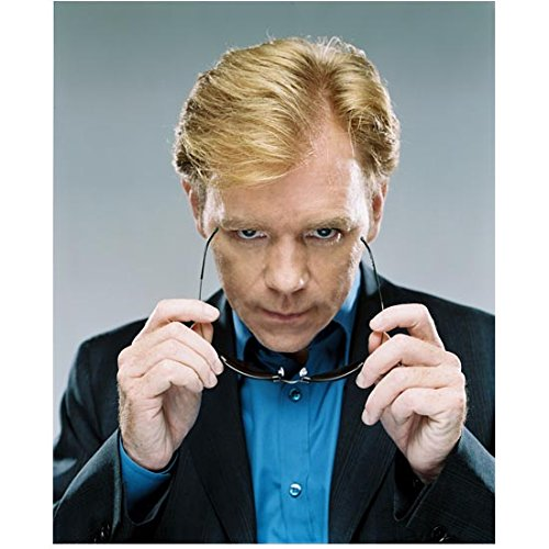CSI: Miami David Caruso as Lt. Caine putting on sunglasses 8 x 10 Inch ()