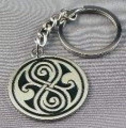 Llavero de metal, diseño con insignia del Doctor Who: Amazon ...
