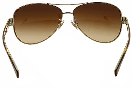 f3e6dfe99ad Coach Women s HC7047 Sunglasses Gold Dark Tortoise Sand Sig C Khaki  Gradient 59mm at Amazon Women s Clothing store