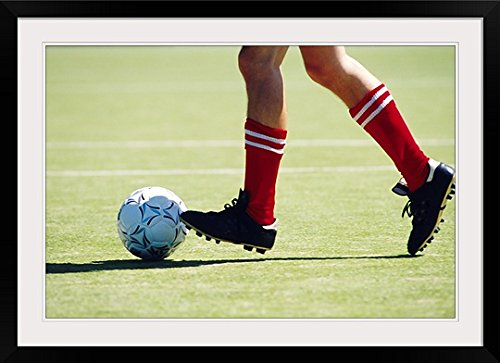 GreatBIGCanvas ''feet of Soccer Player Kicking Ball '' Photographic Print with black Frame, 36'' X 24'''' by greatBIGcanvas