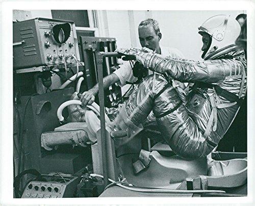 Vintage photo of American astronaut John Glenn climbs the seat at space rack test in Hangar (Climb Seat)