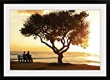 GreatBIGCanvas ''Hawaii, Oahu, Beautiful Sunset Over The ocean with A Couple Sitting on A Bench'' by Brandon Tabiolo Photographic Print with Black Frame, 36'' x 24''