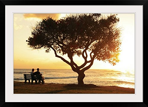 GreatBIGCanvas ''Hawaii, Oahu, Beautiful Sunset Over The ocean with A Couple Sitting on A Bench'' by Brandon Tabiolo Photographic Print with Black Frame, 36'' x 24'' by greatBIGcanvas