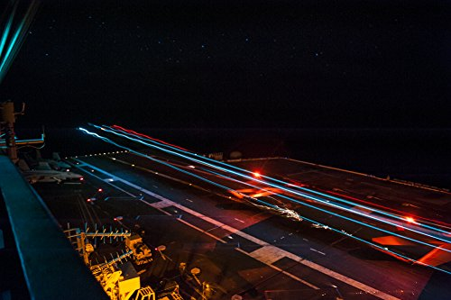 Home Comforts an F/A-18 Hornet assigned to Carrier Airwing (CVW 11) Makes an Arrested Recovery on The Flight Deck