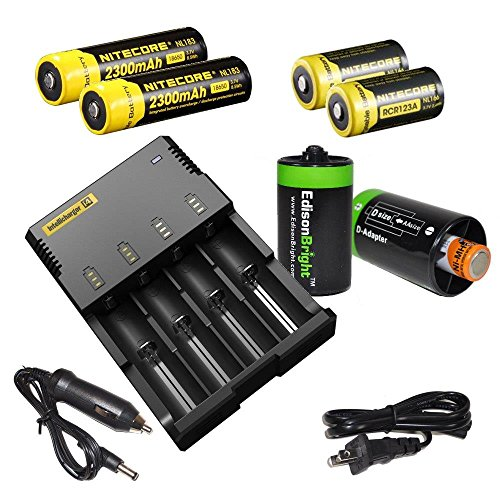 Price comparison product image Nitecore Sysmax Intellicharge i4,  Four Bays universal home / car smart battery charger,  Two Nitecore 18650 NL183 2300mAh rechargeable batteries,  Two Nitecore RCR123 NL166 650mAh rechargeable batteries with 2 X EdisonBright AA to D type battery spacer / converters bundle