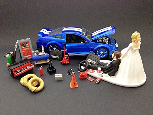 auto-mechanic-car-loving-groom-being-dragged-by-bride-wedding-cake-topper-with-2008-blue-ford-shelby