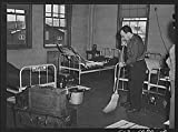 1942''Chaplain David Rubin taking his turn at cleaning and sweeping the chaplains' quarters. Chaplain Rubin is of the Orthodox Jewish faith, and comes from Long Island, New York.