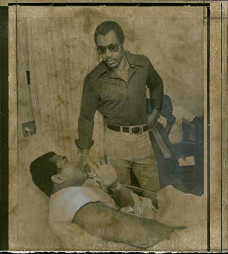 - Vintage photo of Ken Norton with muhammad ali.