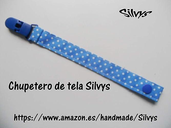 Chupetero de tela con clip Silvys de color azul con lunares, sujeta ...