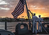 Home Comforts Sailors take down the flag aboard the USS MIssouri during an official dinner atteded by Secretary of
