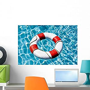 Wallmonkeys Life Ring Floating on Top of Sunny Blue Water Wall Decal Peel and Stick Graphic WM204776 (24 in W x 16 in H)