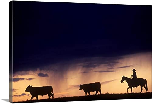 Silhouette of a Cowboy Driving Cattle Canvas Wall Art Print