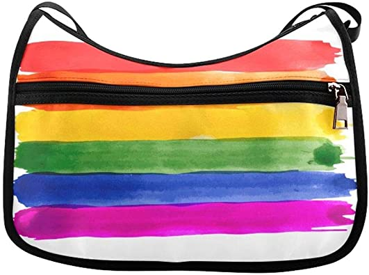 All cotton fabric and fleece lined for stability. Rainbow pride patterned black background medium sized messenger bag with blue lining