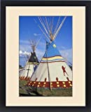 Framed Print of Colorfully painted with decorative designs on Blackfeet tepees made from canvas