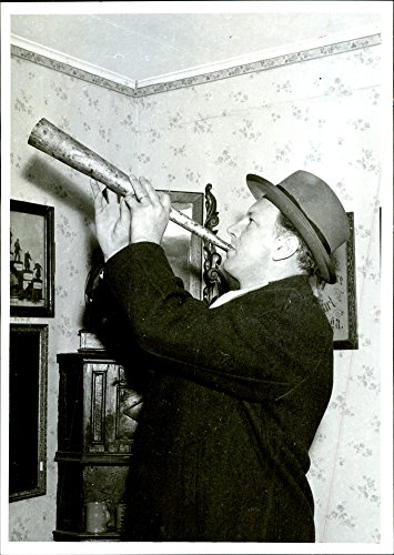 Blow That Horn - Vintage photo of The Hembygdsf246;reningens president A. Olofsson test blows the horn that will occupy a venue at Othinslunda museum
