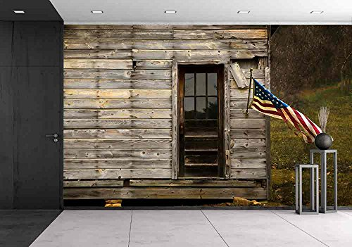 American Flag Hanging from an Old Barn with Negative Space to Display Text