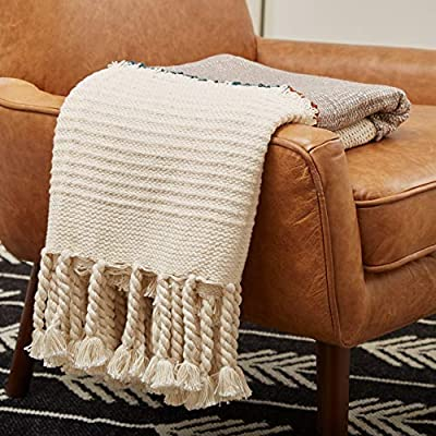 "Amazon Brand – Rivet Modern Global-Inspired Boho Textured Tassel 100% Cotton Throw Blanket - This throw is a comfy, functional work of art. Inspired by archaelogical finds in Mexico's Tulum ruins, it features layers of texture and oversized, hand-tied tassels. Use on a bed, drape over your sofa or hang on the wall for a true style statement. 50""W x 60""L 100% cotton - blankets-throws, bedroom-sheets-comforters, bedroom - 51F30t5pP2L. SS400  -"