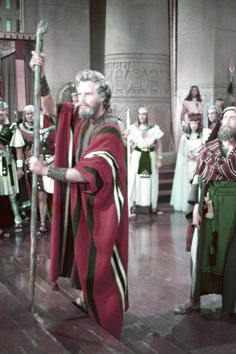 Charlton Heston in The Ten Commandments as Moses with staff 24x36 Poster]()