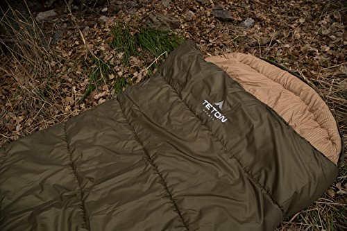 TETON Sports Celsius XXL Sleeping Bag; Great for Family Camping; Free Compression Sack 8 COMFORTABLE SLEEPING BAG FOR ADULTS: Soft lining; Half-circle mummy style hood keeps you warm and your pillow clean; Unzips on each side for airflow and easy access; For camping in 3 seasons NEVER ROLL YOUR SLEEPING BAG AGAIN: TETON provides a great compression sack for stuffing your sleeping bag; Start at the bottom and stuff the bag in, then tighten the heavy-duty straps STAY WARM IN COLD WEATHER: You'll be warm and rested in this sleeping bag; Innovative fiber fill, double-layer construction and draft tubes work together to keep the warmth in