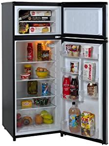 Open fridge with seperate freezer compartment on top