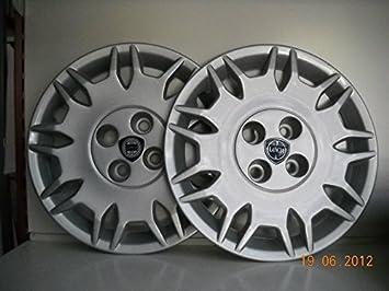 Juego de Tapacubos 4 Y Diseño Tapacubos Lancia Ypsilon Fashion r 14: Amazon.es: Coche y moto