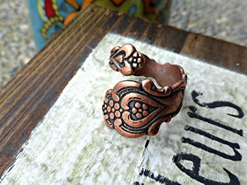 (Copper Spoon ring. Adjustable Ring. Heart center and flower, Size 6-10.)