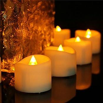 set of 12 restaurant quality rechargeable tealights flickering amber leds 12. Black Bedroom Furniture Sets. Home Design Ideas