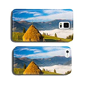 Stack of hay on a green meadow in the mountains cell phone cover case Samsung S5