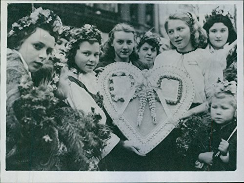 Czech National Costumes - Vintage photo of At he farewell ceremony in Prague, Czech girls in National costumes carried a large decorative heart with portraits of president Benes and General Issimo Stalin,1945.