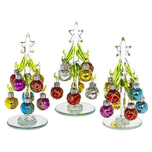 beautiful small glass christmas tree decorated with coloured glittered baubles an