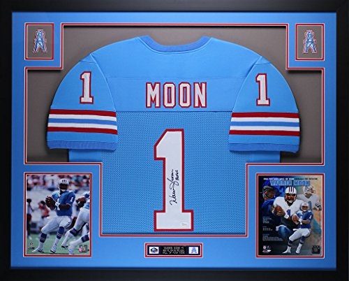 (Warren Moon Autographed Blue Oilers Jersey - Beautifully Matted and Framed - Hand Signed By Warren Moon and Certified Authentic by JSA - Includes Certificate of Authenticity)