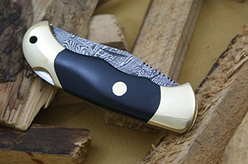 Knife King Damascus Lockback Folding knife. Micarta handle.Razor sharp. Solid quality hunter.Comes with a sheath.