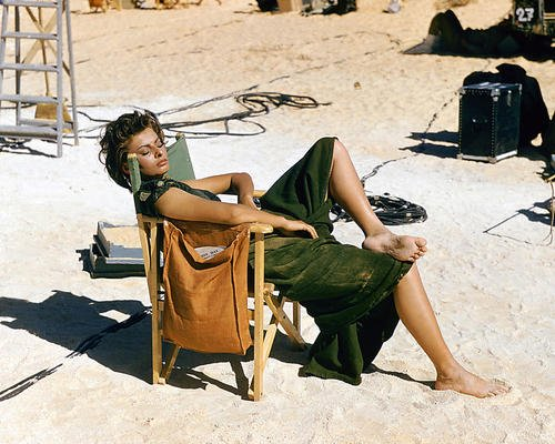 (Sophia Loren 16x20 Poster relaxing in chair on set Legend of the Lost)