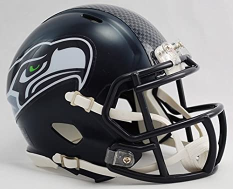 Amazon.com  Seattle Seahawks Riddell Speed Mini Football Helmet - New in  Riddell Box  Sports Collectibles 5d74675f7
