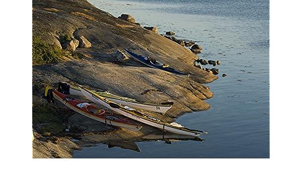 Sea Kayaks sobre rocas en un archipiélago: Amazon.es: Juguetes y juegos